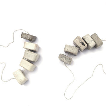 Five gray and white concrete medallions, hangs on 925 silver necklace.