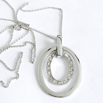Sparkling Modernist 925 Silver Ovals Pendant with Center Oval Prong Set with Small Faceted CZ's - Pendant Hangs from 24 Inch Sterling Chain
