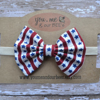 4th of July Bow Headband; Red, White and Blue Star pattern fabric bow on an ivory headband; baby, toddler, or girl's Fourth of July headband