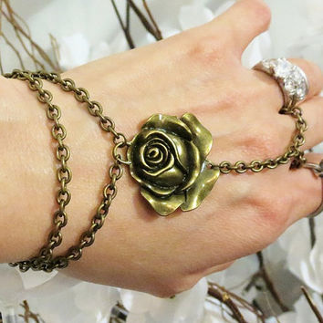 Rose Slave Bracelet Bracelet Ring in Bronze. This is adjustable. Will fit fingers up to sz 15.5. Fits wrists 5.5 to 8 inches.