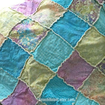 Queen size rag quilt in batiks with aqua, lavender, limey yellows, turquoise lightweight tropical decor quilt