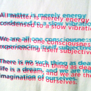 All matter is merely energy condensed to a slow vibration...  T-SHIRT