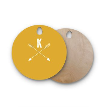 "KESS Original ""Golden Arrow Monogram"" Round Wooden Cutting Board"