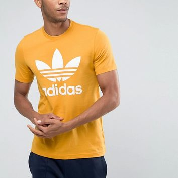 adidas Originals Trefoil T-Shirt In Orange BQ1806 at asos.com