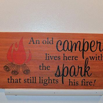 Wooden Wall Sign 10x5 - S008 - An old camper lives here with the spark...