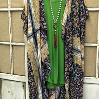 Our Even Now Kimono is the perfect addition to your outfit! It's a short sleeve kimono with a unique print. Very sheer and light and drapes in the front.