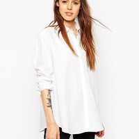 ASOS Oversized Boyfriend Shirt With Curved Hem at asos.com