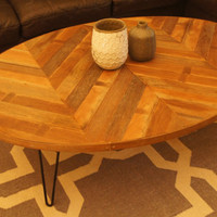 Oval coffee table with chevron pattern - a modern piece handcrafted out of wood with steel hairpin legs