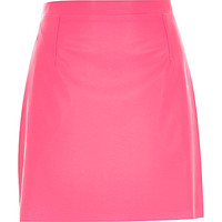 Bright pink leather-look A-line skirt