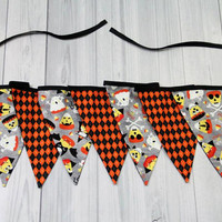 Halloween Banner. Bunting. Candy Corn with costumes alternating with black & Orange Argyle.
