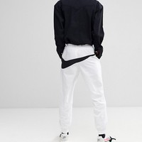 Nike Vaporwave Joggers With Large Swoosh In White AJ2300-100 at asos.com
