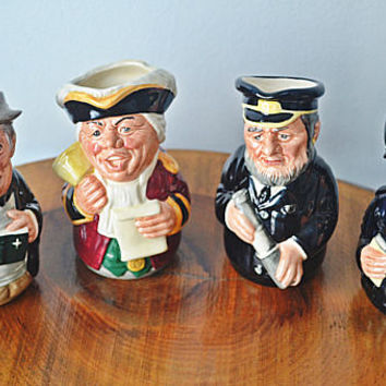 4 1980's Doultonville Collection Toby Jugs, Royal Doulton Character Creamers, The Clergyman, The Town Crier, The Sea Captain, The Policeman