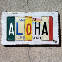 Aloha License Plate Sign on Wood