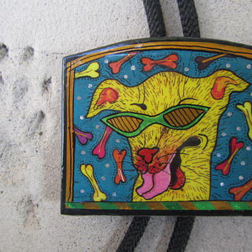 Funky Vintage Bolo Tie Hand Painted Yellow Hollywood Dog . I Dream of Bones in my Green Sunglasses .  FUNKY and signed