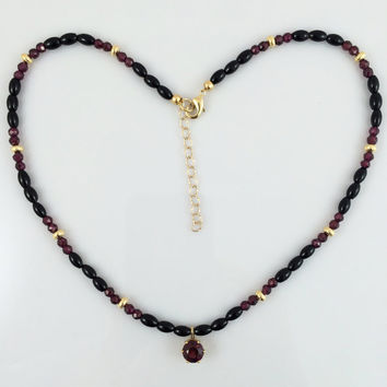Round Faceted Raspberry Rhodolite Garnet Pendant Necklace with Rhodolite Garnet, Black Onyx, and Gold Plated Beads -- Product N052