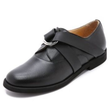 Rubber Strapped Oxfords