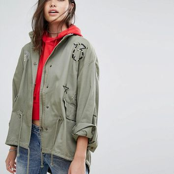 Missguided Khaki Badge Details Parka Jacket at asos.com