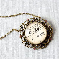 Sheet music necklace.  Romantic shabby style pendant made with vintage sheet music and pink crystals