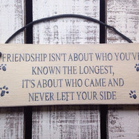rustic wooden sign. for dog owners. friendship.