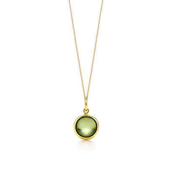 Tiffany & Co. - Paloma Picasso® peridot dot charm in 18k gold on a chain.