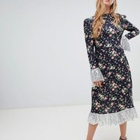 ASOS DESIGN midi dress in ditsy print with sequin detail at asos.com