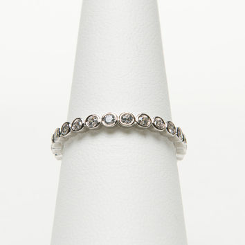 Sterling silver, rhodium plated all around clear cz diamond stackable ring