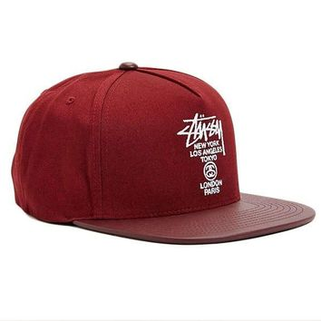 690fced7e The World Tour Maroon Snapback Hat by Stussy