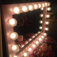 Paris Pink lighted vanity mirror. Use to apply make up, hair or both!Wood frame, painted light pink. G50 bulbs INCLUDED!