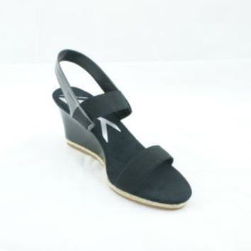 ab23fc7116fd Anne Klein Florence Black Patent Leather Open Toe Wedge Sandals