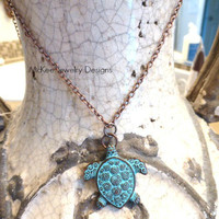 Copper turtle necklace with green patina.