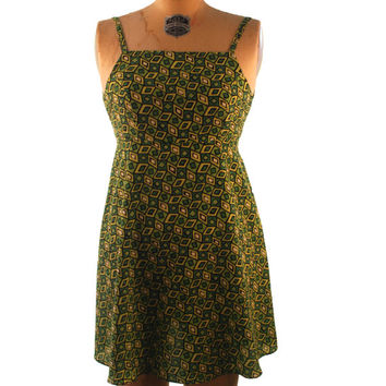 1990s. shades of green. abstract. diamond print. mini dress with empire waist. extra small-small