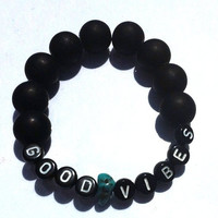 Good vibes black and turquoise stretch by Hannahraejewelry on Etsy