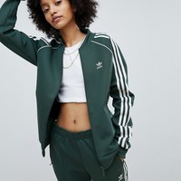 adidas Originals adicolor Three Stripe Track Jacket In Green at asos.com