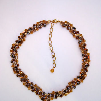 Beaded  necklace, choker style with copper tila beads, copper bicones,gold Miyuki seed beads and topaz glass crystals in wavy pattern.