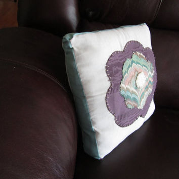 Deco Flower is a handmade, hand-appliqued decorative throw pillow.
