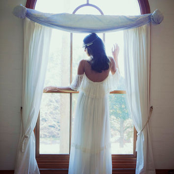 Beautiful low back, off the shoulder, French lace wedding dress for the boho bride
