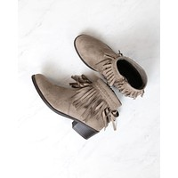 faux suede fringe western inspired boho ankle bootie in taupe