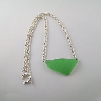 Beautiful Green Sea glass, with fish imprint, pendant on silver chain