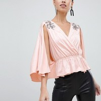 ASOS DESIGN wrap peplum kimono sleeve top with embellishment at asos.com