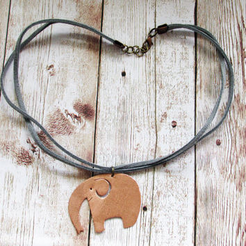 Choker necklace with copper elephant pendant. This necklace is a fun statement jewellery gift for animal lovers, girlfriend, wife, or teen