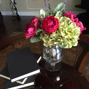 Fushia peonies and roses with green hydrangia in Mercury glass footed vase