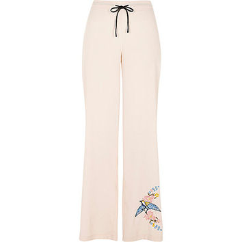 Pink embroidered bird pyjama trousers