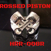 Crossed Pistons Ring