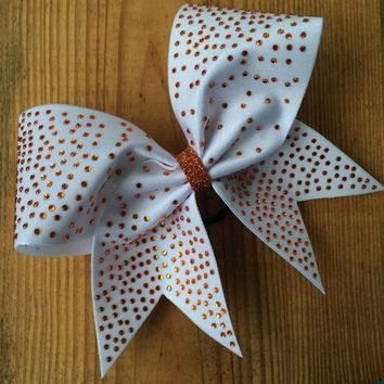 White bow with scattered rhinestones of your choice.
