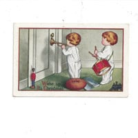 1917 Postmarked Christmas Embossed Color Postcard featuring 2 Adorable Children Trying to Wake Parents, Has a 2 Cent Stamp