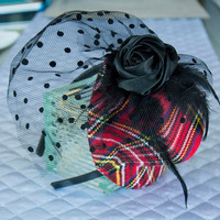 "Plaid Mini Top Hat - ""Avril"" Red Plaid Mini Top Hat is embellished with a black rose, feathers and black veil netting"