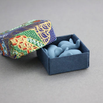 three elephants in an origami box elephant miniature tiny elephant figurines totems blue