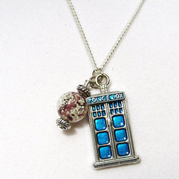 Starry night  tiny tardis necklace , with glow in the dark glass bead .inspired by the Van Gogh episode