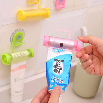 2pcs Plastic Rolling Tube Squeezer Toothpaste Easy Dispenser Bathroom Holder Hot