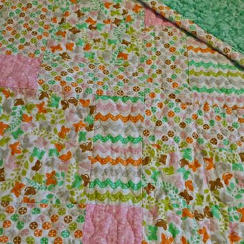Free-motion Quilted Crib sized blanket in pastel colors